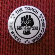 The Torch Badge